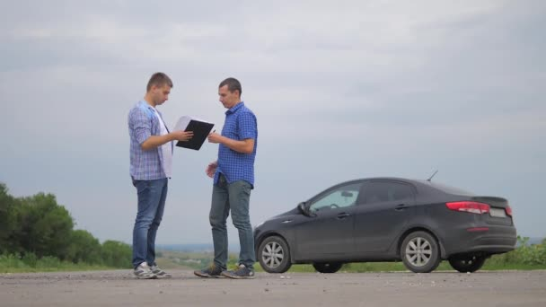 two men lifestyle make a deal. man seller driver makes car the auto insurance slow motion video sale sells used cars. car insurance sale of used cars concept. Buying rent a car