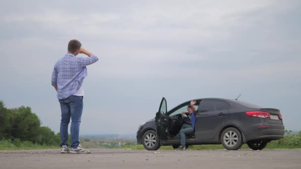 two men make deal. man seller driver makes car the auto insurance slow motion video sale sells used cars. Buying rent a car . man car insurance sale of lifestyle used cars concept