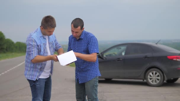 two men make a deal. man seller driver makes car the auto insurance slow motion video. man sale sells used cars. car insurance lifestyle sale of used cars concept
