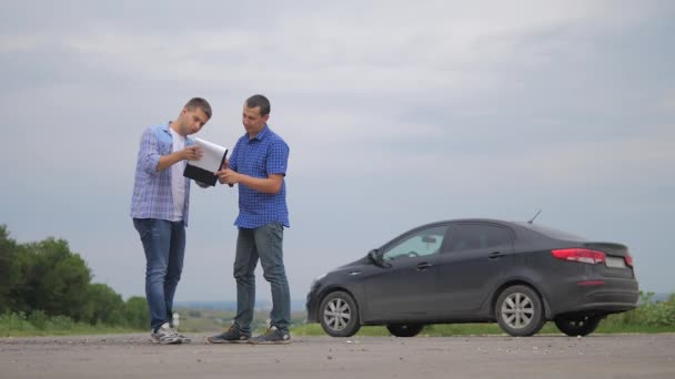 two men make deal. man seller driver makes car the auto insurance slow motion video sale sells used cars. Buying rent a car . man car insurance sale of used cars concept. man test drive lifestyle car