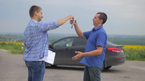two men make a deal. man seller driver makes car the auto insurance slow motion video. man sale sells used cars. car insurance sale lifestyle of used cars concept. Buying rent a car