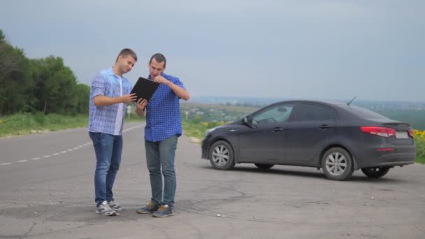 two men make a deal. man seller driver makes car the auto insurance slow motion video. man sale sells used cars. lifestyle car insurance sale of used cars concept. Buying rent a car
