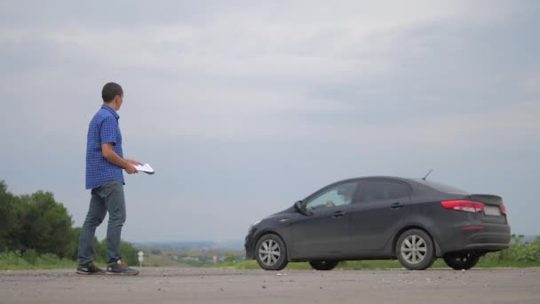 man buys a used car. two men make a deal. man seller driver makes car the auto insurance slow motion video sale sells used cars. lifestyle car insurance sale of used cars concept