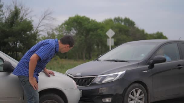 Two men arguing conflict after a car accident on the road car insurance. slow motion video. Two Drivers man Arguing After Traffic Accident. auto insurance accident concept men. lifestyle Two men