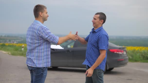 two men make deal. man seller driver makes car the auto insurance slow motion video. man sale sells used cars. car insurance sale of lifestyle used cars concept. Buying rent a car