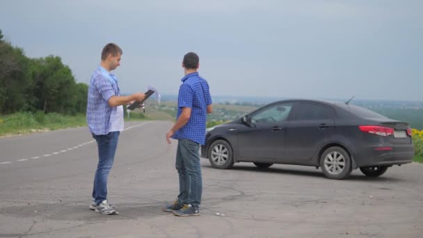 two men make a deal. man seller driver makes car the auto insurance slow lifestyle motion video sale sells used cars. car insurance sale of used cars concept. Buying rent a car