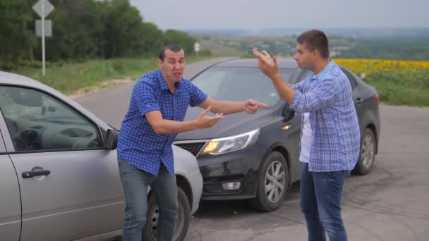 Two men arguing conflict after a car accident on the road car insurance. slow motion video. lifestyle Two Drivers man Arguing After Traffic Accident. auto insurance accident concept men