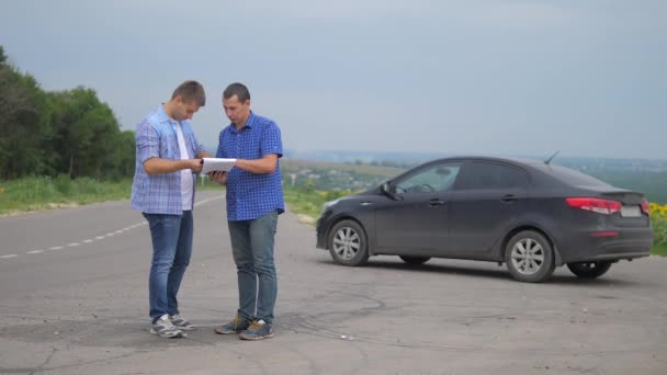 two men make a deal. man seller driver makes car the auto insurance slow motion lifestyle video sale sells used cars. car insurance sale of used cars concept. Buying rent a car