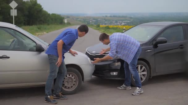 Two men arguing conflict after a car accident on the road car insurance. slow motion lifestyle video. Two Drivers man Arguing After Traffic Accident. auto insurance accident concept men. Two men