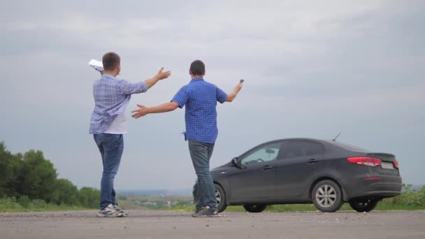 two men make deal. man seller driver makes car the auto insurance slow motion video sale sells used cars. Buying rent a car . man car insurance sale of used cars concept lifestyle