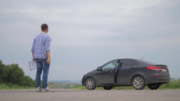 two men make deal. man seller driver makes car the auto insurance slow motion video sale sells used cars. Buying rent a car . man car insurance sale lifestyle of used cars concept