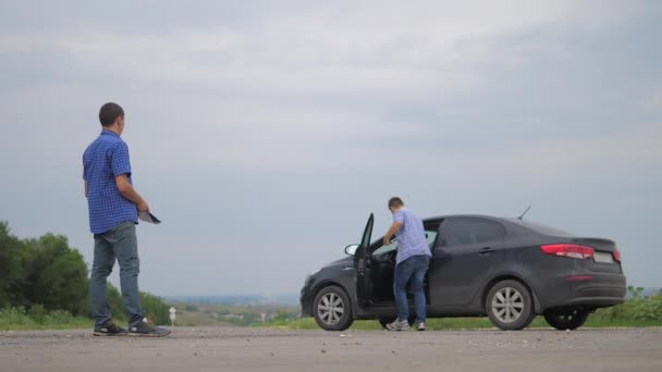 two men make deal. man seller driver makes car the auto insurance slow motion video sale sells used cars. Buying rent a car . man car insurance sale of used cars concept lifestyle. man test drive car