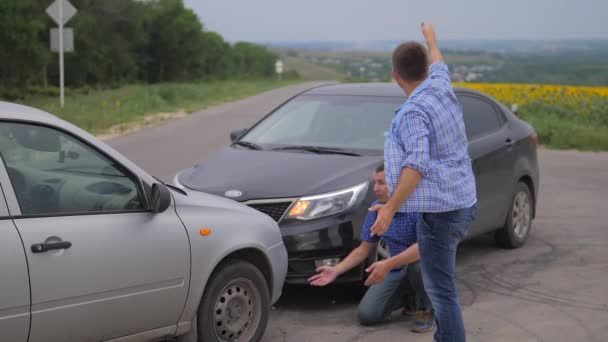 Two men arguing conflict after a car accident on the road car lifestyle insurance. slow motion video. Two Drivers man Arguing After Traffic Accident. auto insurance accident concept men