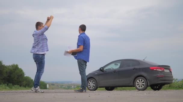 man buys a used car. two men make a deal. man seller driver makes car the auto insurance slow motion video sale sells used cars. car insurance sale of used cars lifestyle concept