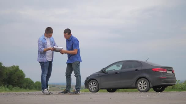 two men make deal. man seller driver makes car the auto insurance slow motion video sale sells used cars. Buying rent a car . man car insurance sale of used cars concept. man lifestyle test drive car