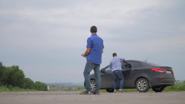 two men make deal. man seller driver makes car the auto insurance slow motion video sale sells used cars. Buying rent a car . man car insurance sale of used cars concept. man test lifestyle drive car