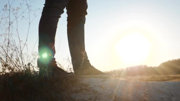 man walking tourists feet legs sneakers shoes hiking adventure climbers sunset climb the mountain . slow motion video. hiker sunlight on top win victory the hill white rock. extreme outdoor activity