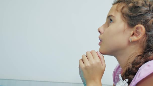 Cute little girl praying at home. little girl prays in the evening before lifestyle bedtime bed. little girl and religion concept Faith in God