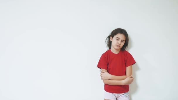 sad and depressed little girl standing by the wall. girl children sad emotions. little girl experiencing suffering lifestyle concept