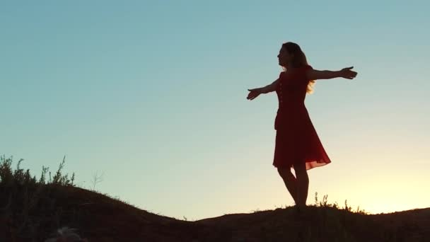 girl whirling silhouette sunset concept freedom. slow motion video. girl hands apart nature sunset sunshine sunlight happiness joy lifestyle