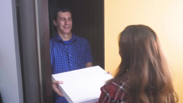 pizza delivery concept. man delivers a box of pizza to the girl. slow motion video. fast food concept lifestyle fast food delivery