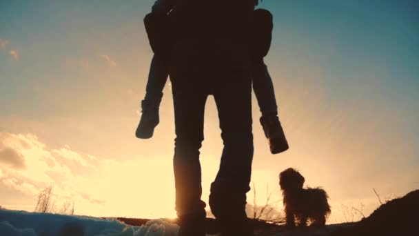father and daughter teamwork happy family tourists silhouette concept rides on his back funny video . livestyle team dad and daughter on sunset play dabble the top of the mountain with backpacks