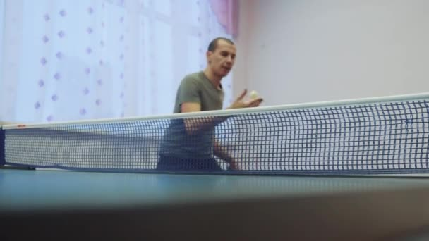 table tennis forehand concept. slow motion video lifestyle. blurred focus man playing training table tennis the sport active
