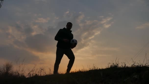 man is training freestyle bal Hacky On Sunset Sack silhouette freestyle concept. man playing soccer stuffing a ball. sport and leisure concept lifestyle