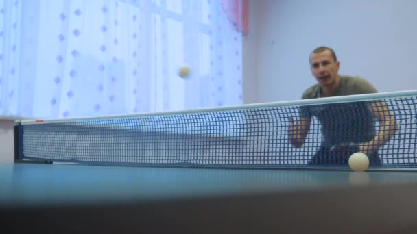 table tennis lifestyle backhand concept. slow motion video. blurred focus man playing training table tennis the sport active