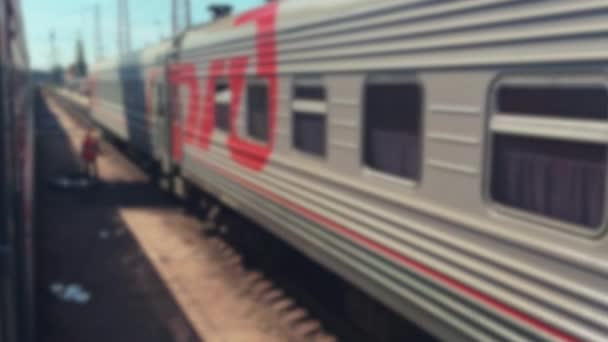 railroad travel concept. departure train wagons movement locomotive train with passenger wagon carriages moving by outside rail. tourism travel lifestyle by the rail