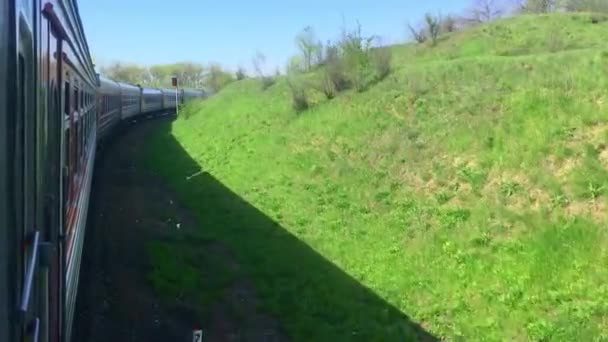 lifestyle railroad travel concept. locomotive train with passenger wagon carriages moving by rail outside in nature beautiful view. tourism travel by the rail