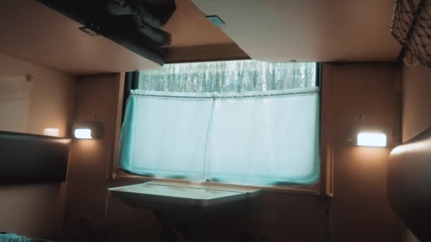interior wagon railway carriage inside a railroad car. concept travel journey train. view beautiful from the window of a moving train railway winter lifestyle Russia. inside train interior