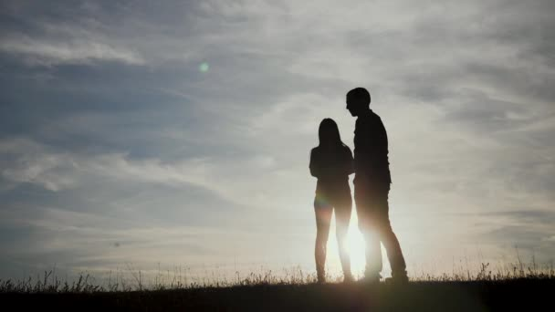 happy family a teamwork Silhouette, happy children with mother and father, family at sunset, summertime slow motion video lifestyle