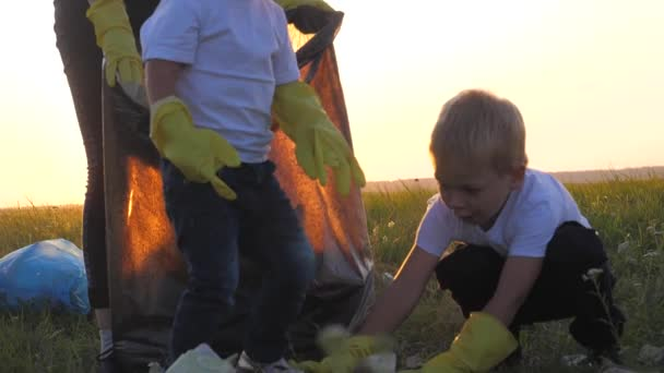 environmental teamwork blurred background a ecology teamwork silhouette volunteers awareness pollution household waste sunset time concept. group happy family of people collects garbage pastic and