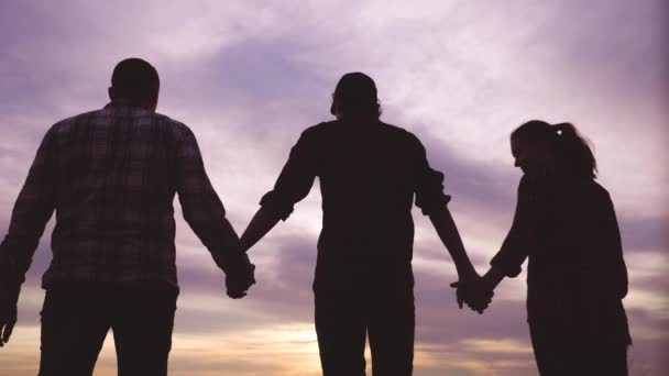 teamwork. team community hold hands together silhouette at sunset unity. group of people hands. teamwork workers carry out one mission go to the goal . business team in the company working partnership
