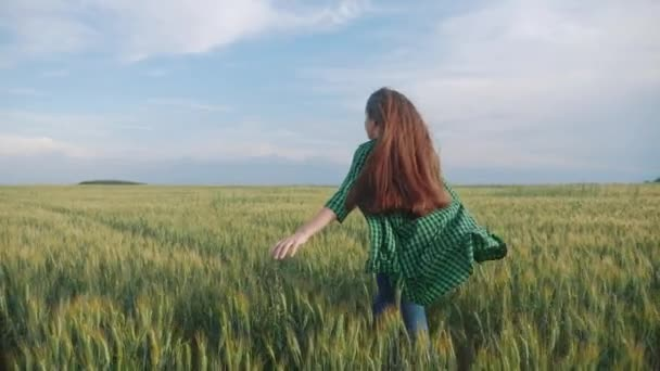 teen girl kid back view run rejoices across the field to meet the sunlight hair flutter. daughter happy family freedom freedom dreams people outdoors childhood concept. girl sister runs on a wheat