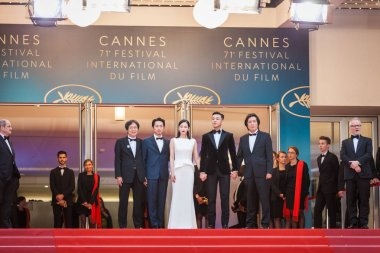 CANNES, FRANCE - MAY 16,  2018: Steven Yeun, Jong-seo Jeon, Yoo Ah In and Chang-dong Lee  attending carpet of the screening of 'Burning' during the 71st annual Cannes Film Festival