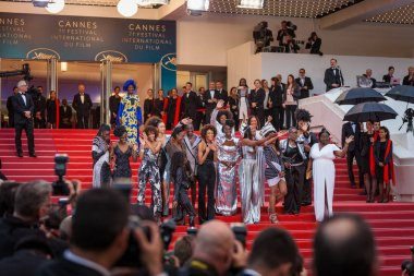 CANNES, FRANCE - MAY 16, 2018: Authors of book 'Noire N'est Pas Mon Mtier' (Black is Not My Job) pose on the stairs with Jury member Khadja Nin at the screening of 'Burning' during the 71st annual Cannes Film Festival