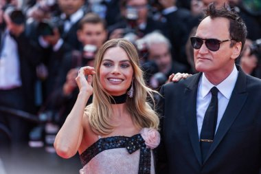 CANNES, FRANCE - MAY 21, 2019: Quentin Tarantino and Margot Robbie attend the screening of
