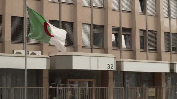 FRANKFURT, GERMANY - AUGUST 5, 2017: The Algerian flag flies high in the breeze at the Embassy of Algeria in Frankfurt, Germany.