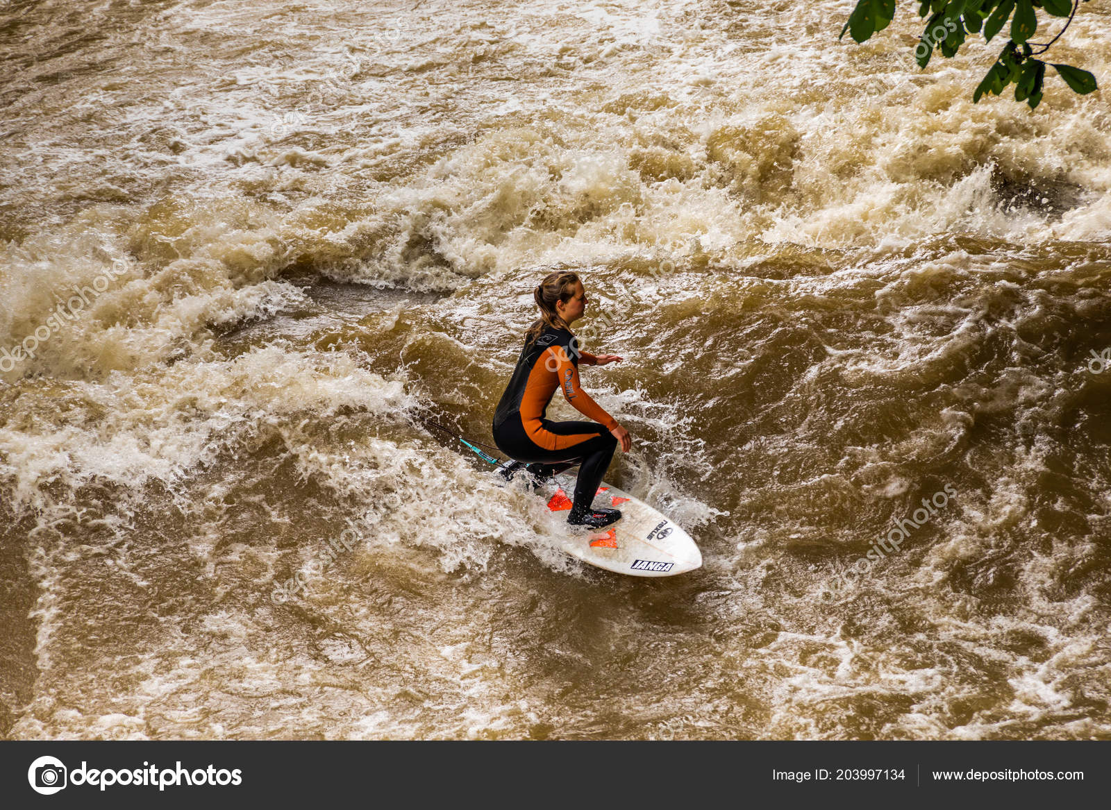 MUNICH-JUNE 14. Surfer man on the Eisbach in the English Garden in ...
