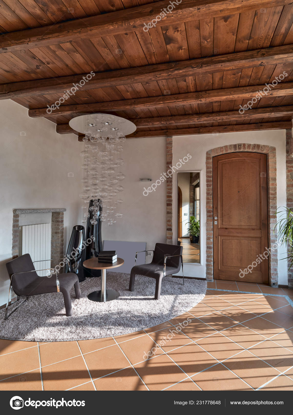 Picture of: Leather Armchairs Table Living Room Tiles Floor Wood Ceiling Stock Photo C Aaphotograph 231778648