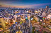 Fotografie Shibuya, Tokyo, Japan city skyline over the famous scramble crosswalk at dusk.