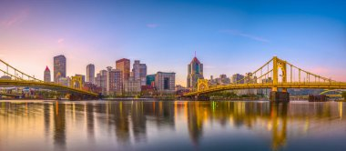 Pittsburgh, Pennsylvania, USA panorama skyline on the Allegheny River at dusk.