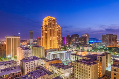 New Orleans, Louisiana, USA downtown CBD skyline at night.