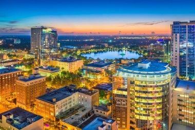 Orlando, Florida, USA aerial cityscape towards Lake Eola at dusk.