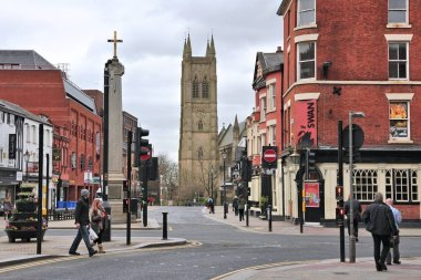 BOLTON, UK - APRIL 23, 2013: People visit a shopping street in Bolton, UK. Bolton is part of Greater Manchester, one of largest population areas in the UK (2.68m people living in the county).