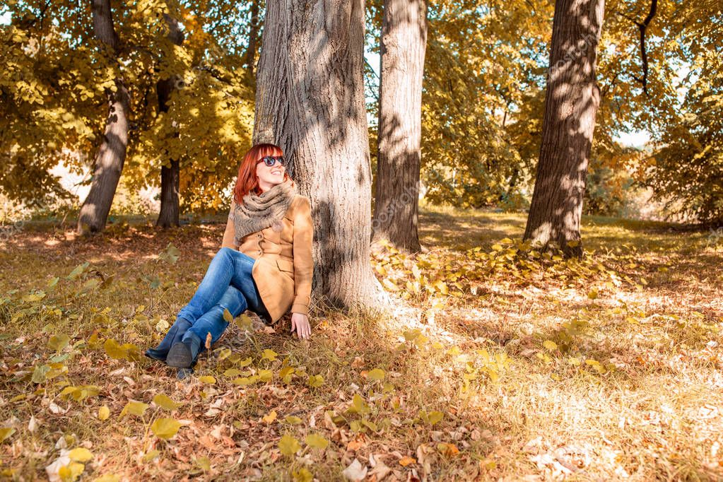 Young Smiling autumn woman enjoying in nature