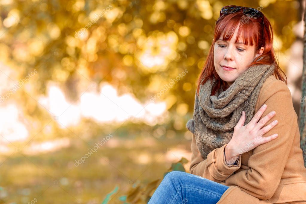 Portrait of Young ginger woman enjoying in nature