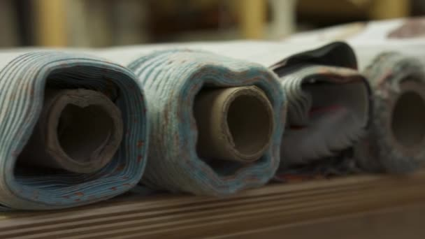 Worker get a roll of cloth. Warehouse materials for the production of clothing. Slow slide camera 4k